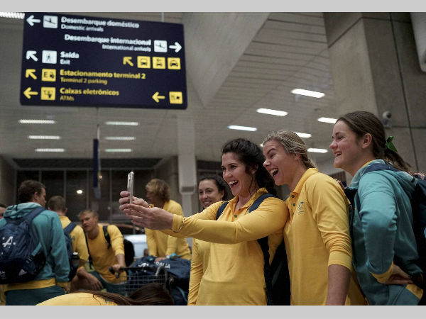 Australia's olympic athletes take a selfie after arriving at the Tom Jobim International Airport, in Rio de Janeiro on July 26