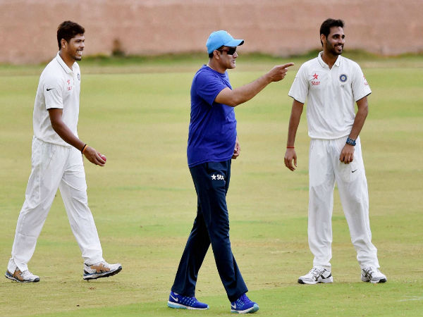 Head Coach Anil Kumble, Bhuvneshwar Kumar and Umesh Yadav during a practice match on the fifth day of the preparatory camp ahead of West Indies tour at Alur Cricket Ground in Bengaluru.