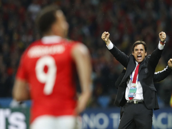 Chris Coleman (right) celebrates after Wales victory