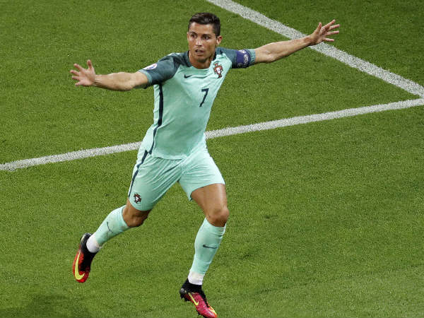 Cristiano Ronaldo celebrate after scoring against Wales