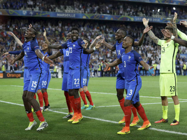 French players celebrate after the Euro 2016 semifinal soccer match between Germany and France