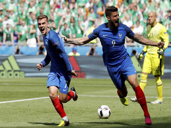 Olivier Giroud (right) celebrates after scoring a goal for France