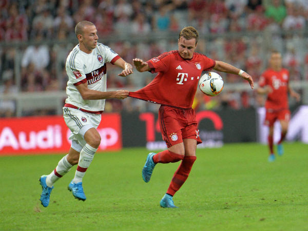 Bayern Munich's Mario Goetze (right) challenge for the ball with AC Milan's Luca Antonelli during a friendly match in 2015