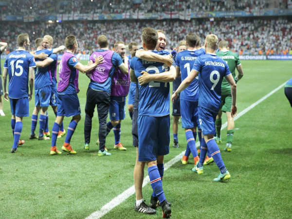 Iceland's players celebrate at the end of the Euro 2016 round of 16 match between England and Iceland