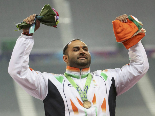 A file photo of shot putter Inderjeet Singh posing with his gold medal at the 21st Asian Atheletics Championships in Wuhan, China, in June 2015