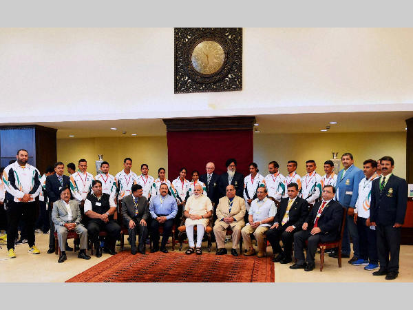 Prime Minister Narendra Modi and Minister of State for Youth Affairs and Sports, Jitendra Singh in a group photograph with the Indian contingent for Rio Olympics during a warm send-off ceremony organised for the athletes, in New Delhi on Monday.