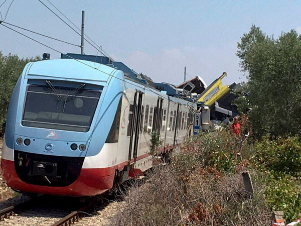 A view of the scene of a train accident after two commuter trains collided head-on near the town of Andria, in the southern region of Puglia, killing several people, Tuesday, July 12, 2016.