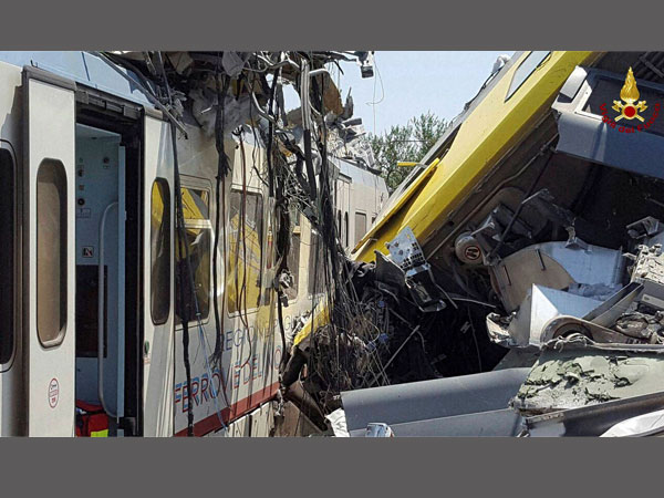 Andria: Crumpled wagon cars are seen after after two commuter trains collided head-on near the town of Andria, in the southern region of Puglia, killing several people, Tuesday, July 12, 2016.