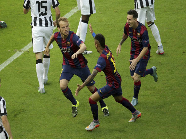 Ivan Rakitic (left) celebrates scoring the opening goal during the Champions League final against Juventus in 2015