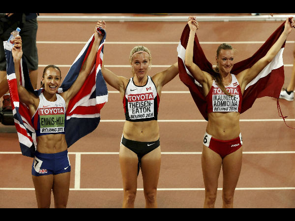 Britain's gold medal winner Jessica Ennis-Hill, Canada's silver medal winner Brianne Theisen Eaton and Latvia's bronze medal winner Laura Ikauniece-Admidina, from left, celebrate after the women's heptathlon at the World Athletics Championships at the Bird's Nest stadium in Beijing, on Aug 23, 2015.