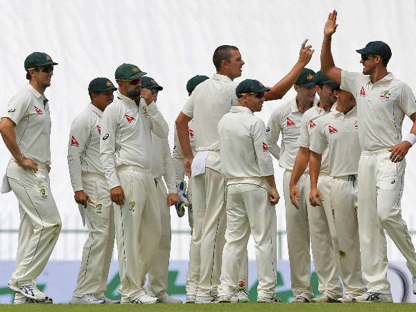 Australian players celebrate a Sri Lankan wicket on the first day
