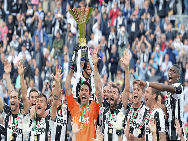 Juventus' Gianluigi Buffon holds up the trophy as he celebrates with teammates their Serie A title
