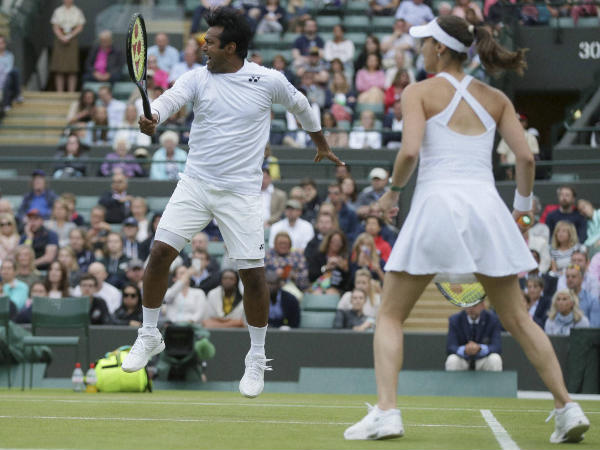 Leander Paes (left) and Martina Hingis during Wimbledon 2016