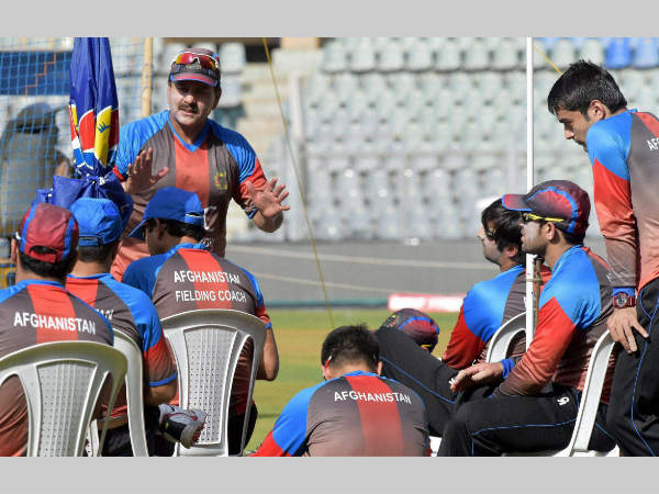 File photo: Afghanistan's bowling coach Manoj Prabhakar (left, standing) interacts with players during a practice session at Wankhede Stadium in Mumbai in March 2016 during World T20