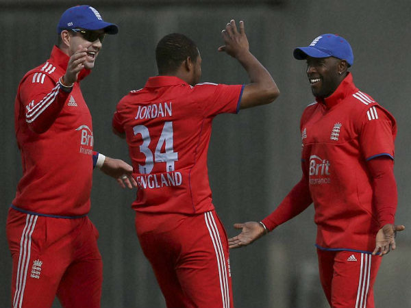 File photo: Michael Carberry (right) celebrates with team-mates Chris Jordan (centre) and Kevin Pietersen during a ODI against Australia in 2013