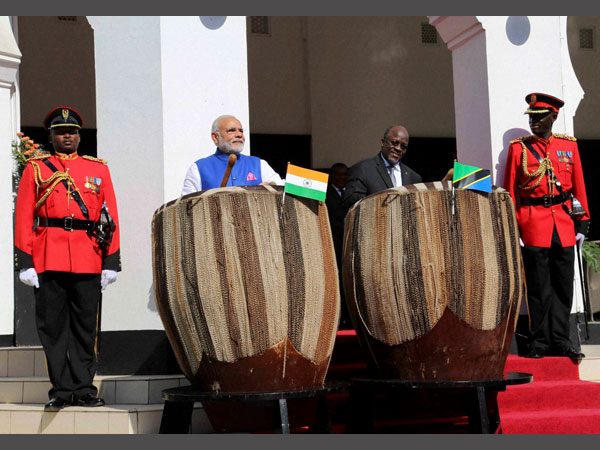 PM Narendra Modi, left, and his host Tanzanian President John Pombe Magufuli, right, beat drums at the entrance of State House during an official welcome ceremony for Modi in Dar es Salaam, Tanzania on July 10.