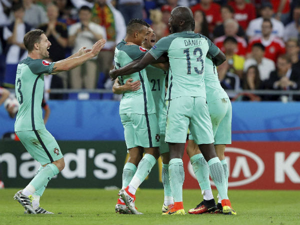 Portugal's Nani, centre, celebrates after scoring his side's second goal during the Euro 2016 semifinal soccer match between Portugal and Wales, at the Grand Stade in Decines-­Charpieu, near Lyon, France, on July 6, 2016.