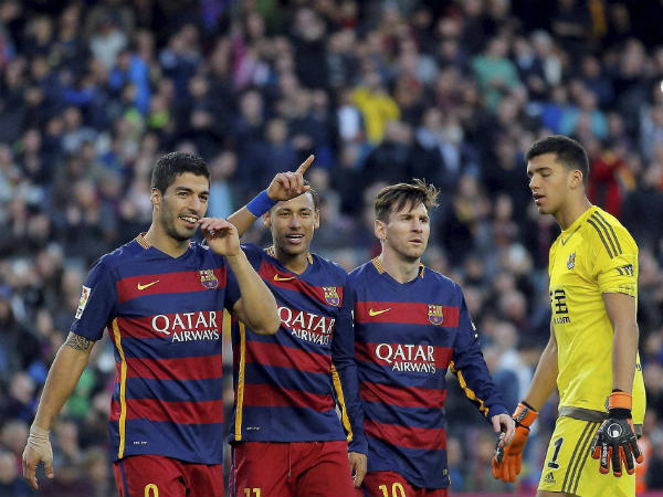 File photo: Barcelona's Neymar, second left, celebrates with his teammates Luis Suarez, left, and Lionel Messi, second right, after scoring against Real Sociedad during a Spanish La Liga soccer match at the Camp Nou stadium in Barcelona, Spain, November 28, 2015