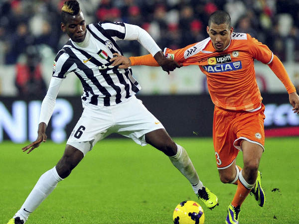 Paul Pogba (left) fights for the ball during a Serie A match