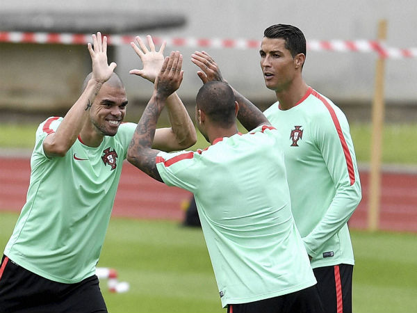Pepe (left), Ricardo Quaresma and Cristiano Ronaldo exercise during a training session