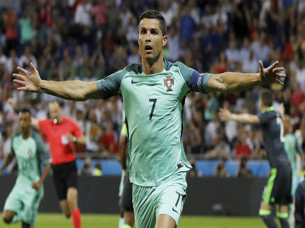 Portugal's Cristiano Ronaldo celebrates after scoring his side's first goal during the Euro 2016 semifinal soccer match between Portugal and Wales