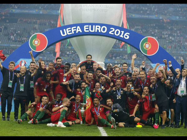 Portugal's team celebrates with the trophy after winning the Euro 2016 final soccer match between Portugal and France at the Stade de France in Saint-Denis, north of Paris, on July 10, 2016