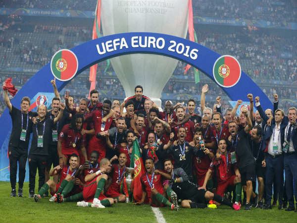 Portugal's team celebrates with the trophy after winning the Euro 2016 final