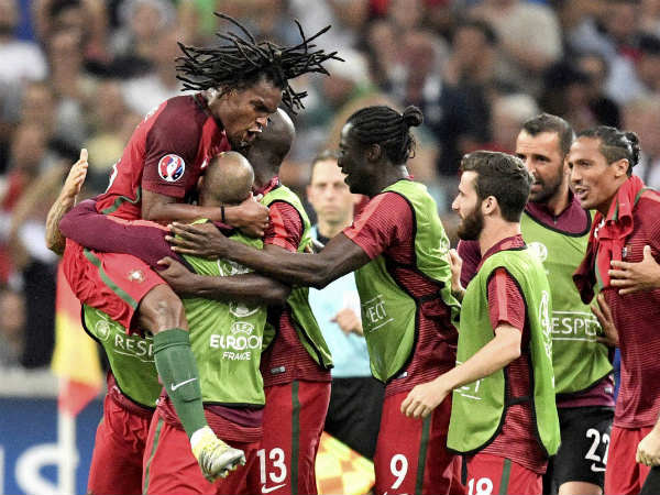 Renato Sanches celebrates with teammates after scoring the equaliser against Poland