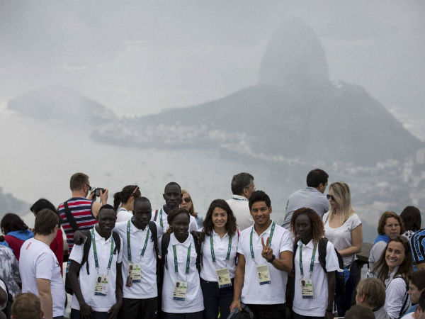 Members of the Refugee Olympic Team pose for a photo with the Sugar Loaf mountain in the background in Rio de Janeiro, Brazil, Saturday