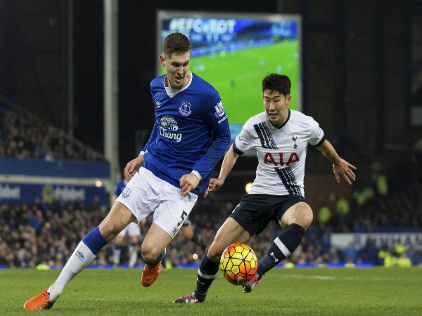 Everton's John Stones (left) fights for the ball against Tottenham's Son Heung-Min during a English Premier League match