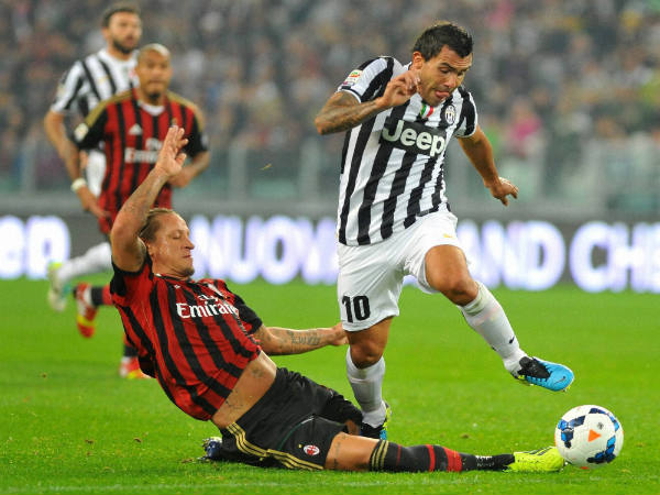 Carlos Tevez (left) in action for Juventus