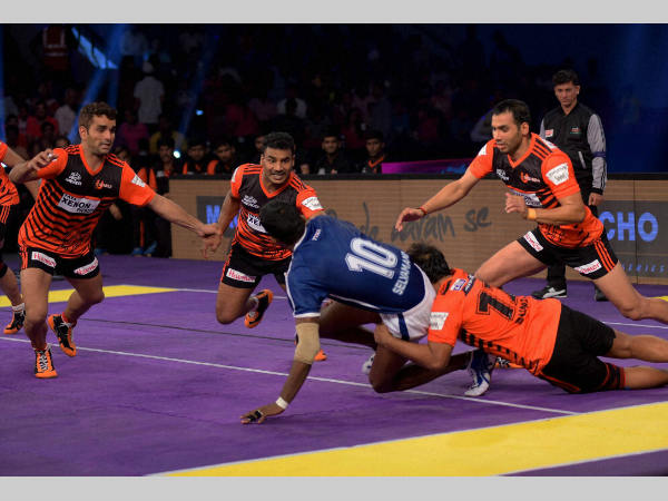 Players of U Mumba and Dabang Delhi in action during the Pro Kabaddi League match at Sawai Mansingh Indoor Stadium in Jaipur on Friday (July 1).