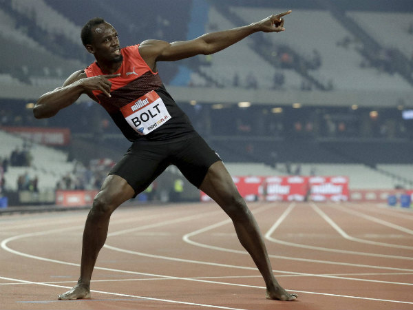 Usain Bolt poses for photographers after he won the men's 200m race during the Diamond League anniversary games