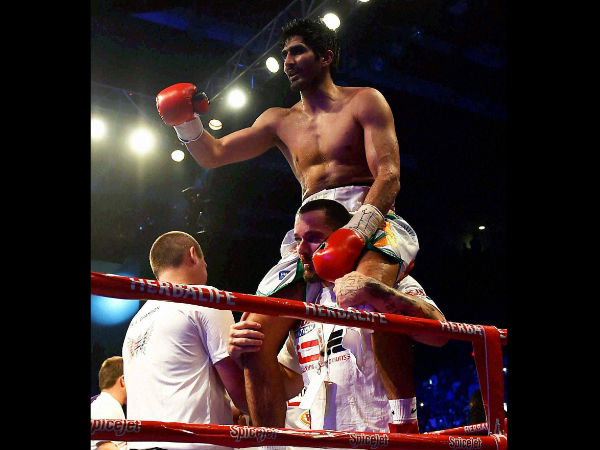Star Indian boxer Vijender Singh celebrates after beating Australia's Kerry Hope and won the WBO Asia Pacific Super Middleweight Championship at Thyagaraj Sports Complex in New Delhi.