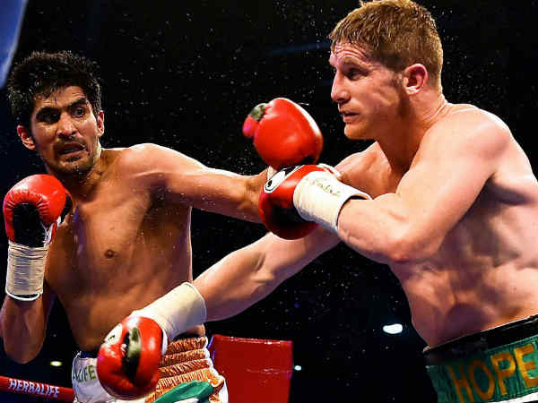 British boxer Amir Khan cautions 'kid' Vijender Singh to be careful what he wishes for