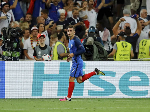 France's Antoine Griezmann celebrates after scoring his side's first goal against Germany in Euro semi-final