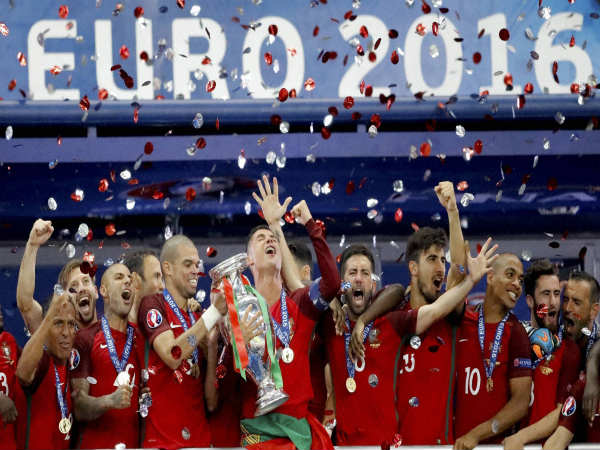 Portugal players hold the trophy at the end of the Euro 2016 final