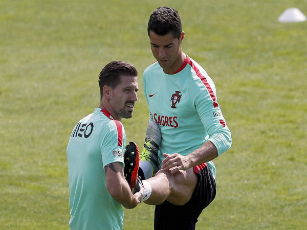 Cristiano Ronaldo (right) stretches with Portugal's Adrien Silva during a training session