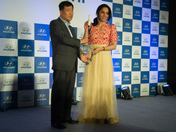 Saina Nehwal (right) hands over her autographed badminton raquet to Hyundai India MD and CEO YK Koo in Bengaluru. Photos by Suhas A