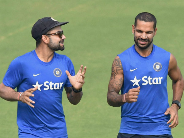 File photo: Kohli (left) and Dhawan run during a training session