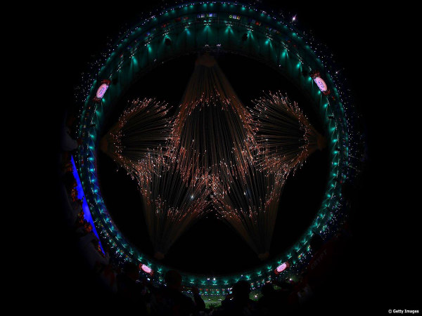 Five rings of the Olympics depicted with fire