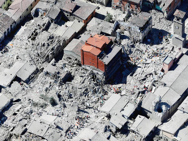 Historical part of Amatrice stands ruined