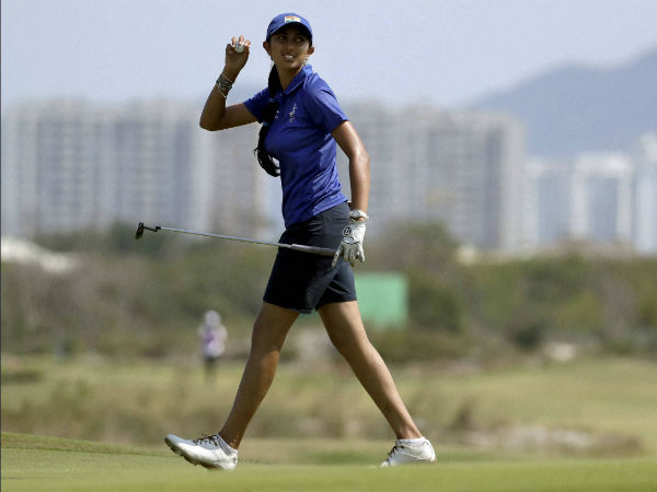 Aditi Ashok of India, walks off the 18th green after completing her second round of the women's golf event at the 2016 Summer Olympics in Rio de Janeiro