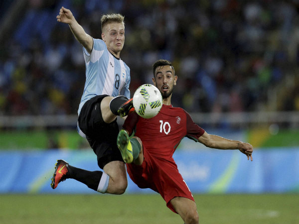 Argentina's Santiago Ascacibar (left) and Portugal's Bruno Fernandes vie for the ball during a group D match of the men's Olympic football tournament