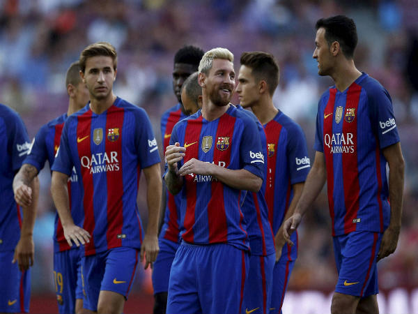 Lionel Messi (centre) alongside his FC Barcelona team mates
