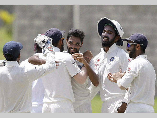 Indian players rejoice after taking a wicket during the Test series against West Indies