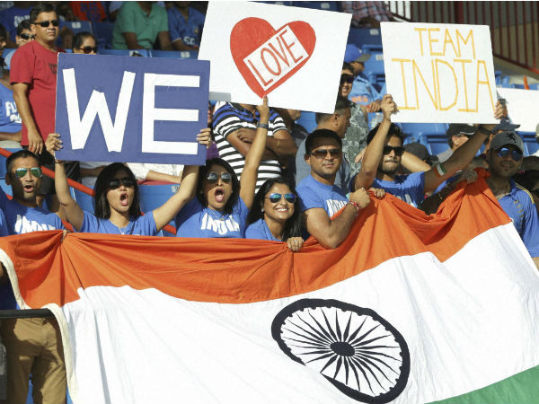 Cricket fans wave the Indian flag before the second Twenty20 international cricket match between India and the West Indies, Sunday, Aug. 28, 2016, in Lauderhill.