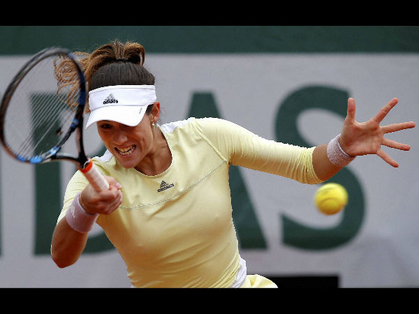 US Open 2016: Garbine Muguruza stutters into second round