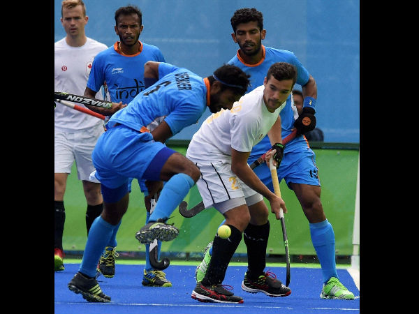 India's (blue) and Canada players in action during their Men's hockey match at Summer Olympics 2016 in Rio de Janeiro, Brazil on Friday.