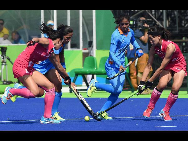 Indian and Japanese women hockey players vie for the ball during qualifying round at the Rio Olympic 2016 at Rio de Janeiro, Brazil on Sunday